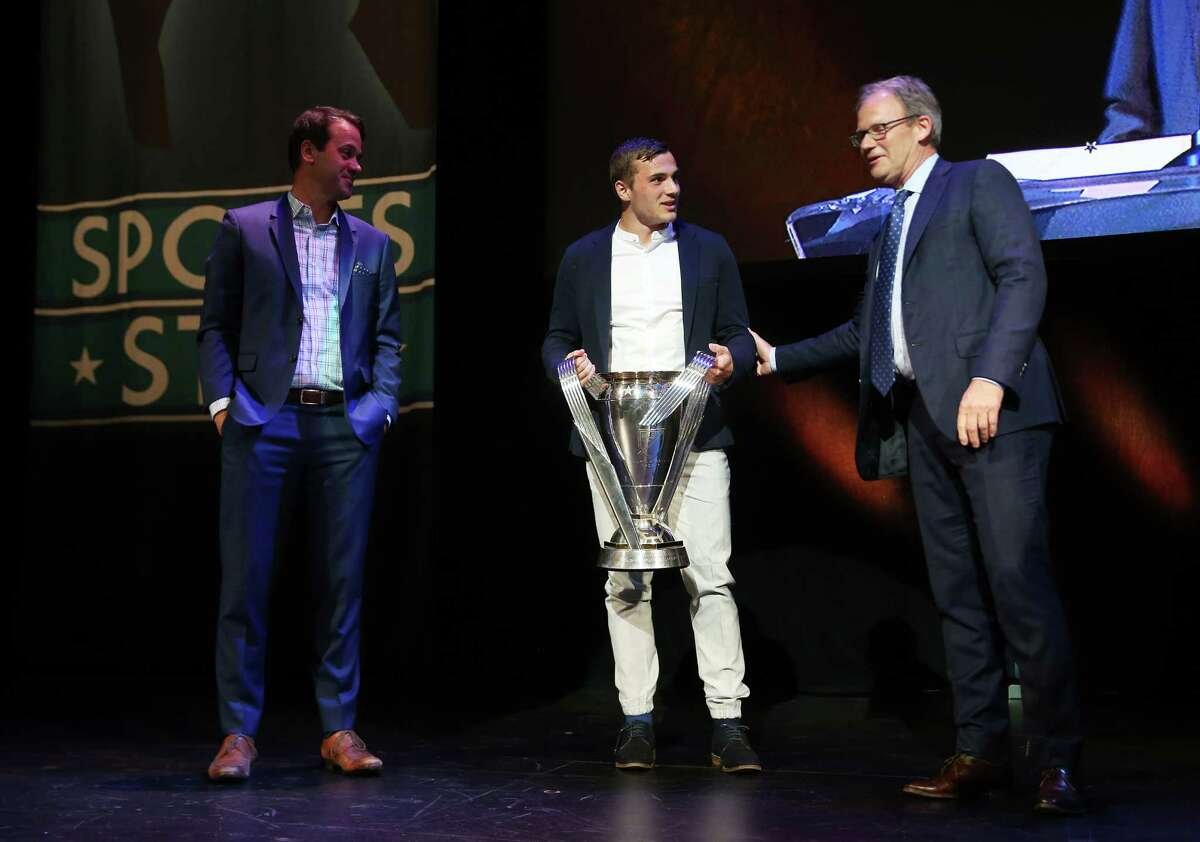 Sounders Jordan Morris holds the MLS Cup as the Sounders accept the 2016 Sports Story of the Year Award during the MTRWestern 82nd Annual Sports Star of the Year Awards, Feb. 8, 2017, at the Paramount Theater.