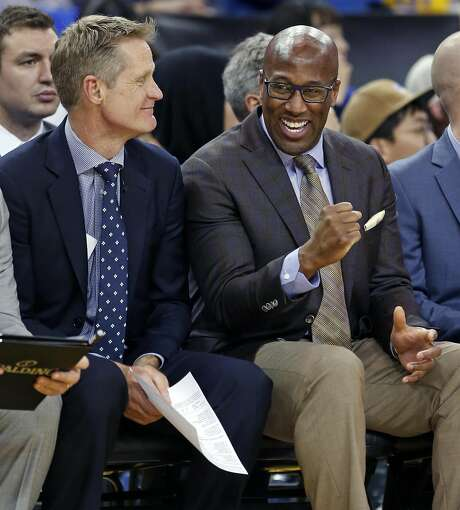 Golden State Warriors' assistant coach Mike Brown with head coach Steve Kerr during 123-92 win over Chicago Bulls in NBA game at Oracle Arena in Oakland, Calif., on Wednesday, February 8, 2017. Photo: Scott Strazzante, The Chronicle