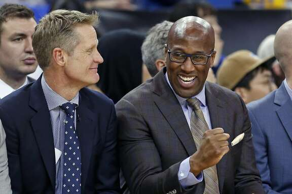 Golden State Warriors' assistant coach Mike Brown with head coach Steve Kerr during 123-92 win over Chicago Bulls in NBA game at Oracle Arena in Oakland, Calif., on Wednesday, February 8, 2017.