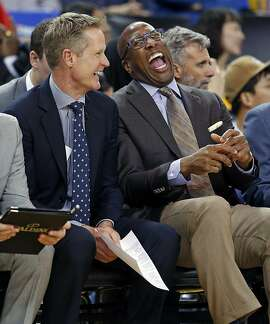 Golden State Warriors' assistant coach Mike Brown laughs with head coach Steve Kerr during 123-92 win over Chicago Bulls in NBA game at Oracle Arena in Oakland, Calif., on Wednesday, February 8, 2017.