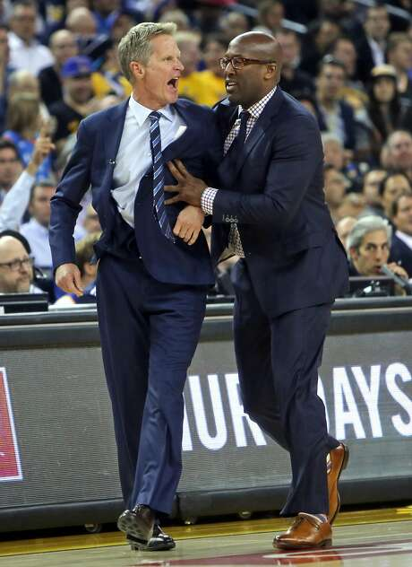 Golden State Warriors' head coach Steve Kerr is restrained by assistant coach Mike Brown after a non-call on a shot by Stephen Curry during NBA game against Oklahoma City Thunder at Oracle Arena in Oakland, Calif., on Thursday, November 3, 2016. Photo: Scott Strazzante, The Chronicle