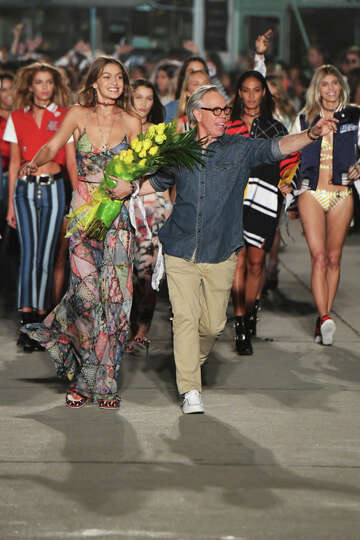 270dfce2 1of38VENICE, CA - FEBRUARY 08: Model Gigi Hadid (L) and fashion designer  Tommy Hilfiger (R) walk the runway at the TommyLand Tommy Hilfiger Spring  2017 ...