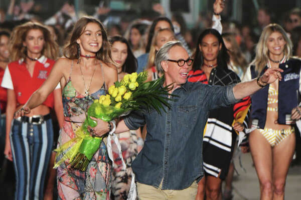 VENICE, CA - FEBRUARY 08:  Model Gigi Hadid (L) and fashion designer Tommy Hilfiger (R) walk the runway at the TommyLand Tommy Hilfiger Spring 2017 Fashion Show on February 8, 2017 in Venice, California.  (Photo by Jeff Kravitz/FilmMagic)