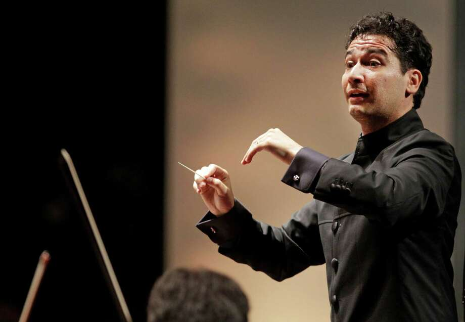 The Houston Symphony with its new music director Andres Orozco-Estrada is shown during performance at Miller Outdoor Theatre, 6000 Hermann Park Dr., Friday, Sept. 12, 2014, in Houston. ( Melissa Phillip / Houston Chronicle ) Photo: Melissa Phillip, Staff / Â 2014  Houston Chronicle