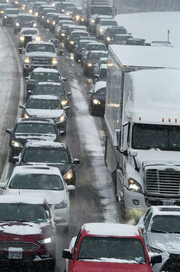 Southbound traffic on I-87 creeps along as a nor'easter hits the Capital Region on Thursday morning, Feb. 9, 2017, in Clifton Park, NY. (John Carl D'Annibale / Times Union) Photo: John Carl D'Annibale / 20039654A