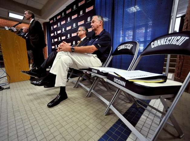 Rick Evrard, the University's outside counsel for NCAA-related matters, right, speaks as Connecticut basketball head coach Jim Calhoun, right, and Director of Athletics Jeff Hathaway listen at a news conference in Storrs, Conn., Friday, May 28, 2010.  The University says the NCAA has found eight violations in the school's men's NCAA college basketball program. (AP Photo/Jessica Hill) Photo: Jessica Hill, AP / Associated Press