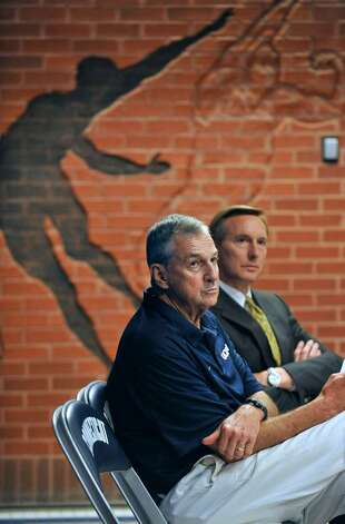 Connecticut basketball head coach Jim Calhoun, left, sits with Rick Evrard, the University's outside counsel for NCAA-related matters, during a news conference in Storrs, Conn., Friday, May 28, 2010.  The University says the NCAA has found eight violations in the school's men's basketball program. (AP Photo/Jessica Hill) Photo: Jessica Hill, AP / Associated Press