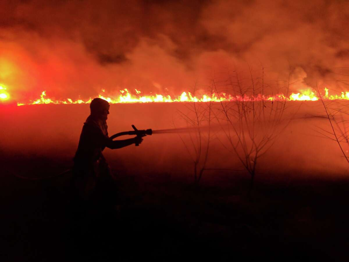 Firefighters in southern Fort Bend County battled a grass fire near the town of Guy for about six hours Wednesday, Jan. 8, 2017. (Photos courtesy of Needville Fire Department)