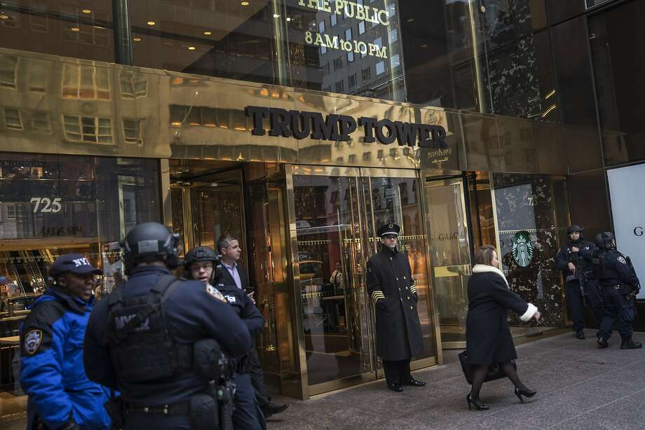 "FILE - Security outside Trump Tower on Fifth Avenue, in Manhattan, Jan. 18, 2017. The Department of Defense has regularly rented space for military aides carrying the ""nuclear football"" to stay when the president travels, and will be doing so at Trump Tower, a move that raises questions of money going directly to President Donald Trump. (Victor J. Blue/The New York Times) Photo: VICTOR J. BLUE, NYT"