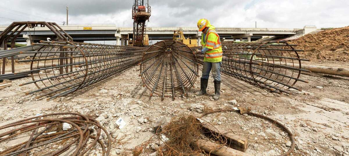 Gerson R. Chavez strings steel for a highway support column beside the northbound lane of Interstate 45 just south of El Dorado on May 5, 2015.