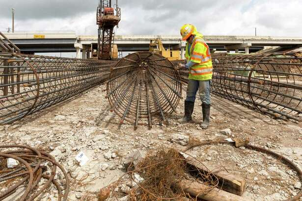 TxDOT is working on widening sections of I-45 south of downtown, especially around NASA Road 1 and Clear Lake. ID: Gerson R. Chavez works stringing steel for a highway support column beside the northbound lane of I-45 just south of El Dorado. Tuesday  May 5, 2015