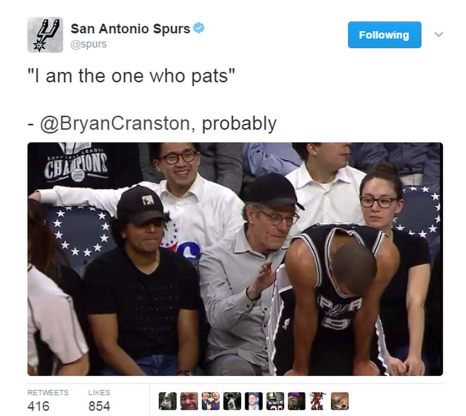 The moment when director M. Night Shymalan and actor Bryan Cranston joked over Spur Tony Parker's buttocks was caught on camera and Twitter.  Photo: Twitter.com/Spurs