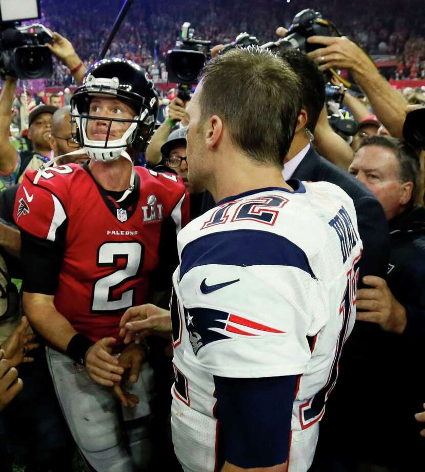 Atlanta Falcons quarterback Matt Ryan looks to the scoreboard as he congratulates New England Patriots quarterback Tom Brady on the Patriots' victory. The Atlanta Falcons lost to the New England Patriots in overtime, 34-28, in Super Bowl LI on Sunday, Feb. 5, 2017 at NRG Stadium in Houston, Texas. (Bob Andres/Atlanta Journal-Constitution/TNS) Photo: Bob Andres, MBR / Atlanta Journal-Constitution