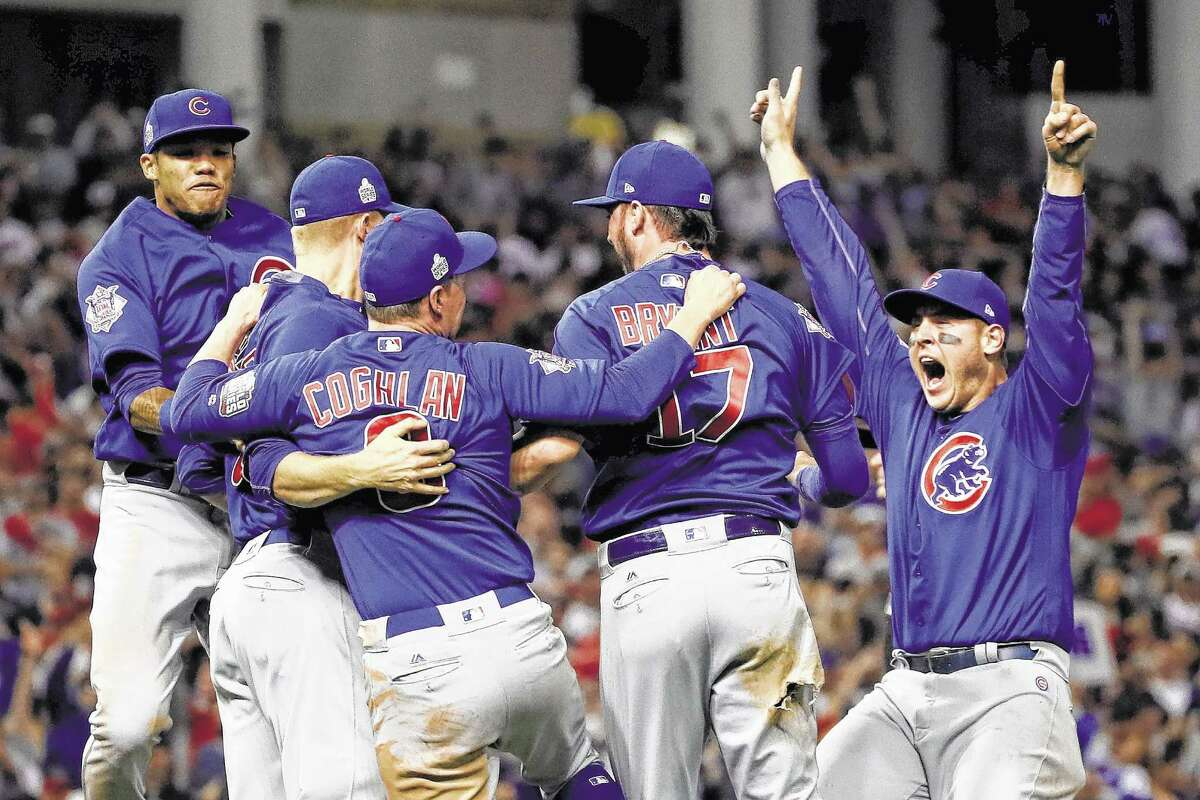 CLEVELAND, OH - NOVEMBER 02: The Chicago Cubs celebrate after winning 8-7 against the Cleveland Indians in Game Seven of the 2016 World Series at Progressive Field on November 2, 2016 in Cleveland, Ohio. The Cubs win their first World Series in 108 years.