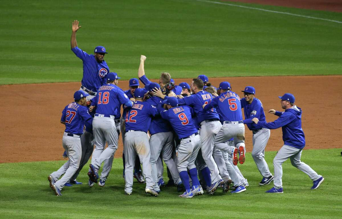 The Chicago Cubs celebrate winning the World Series at the end of Game 7 of the World Series between the Chicago Cubs and Cleveland Indians Thursday, Nov. 3, 2016, at Progressive Field in Cleveland, Ohio.