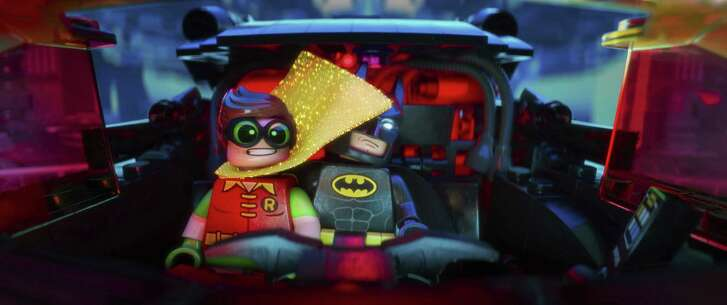 "Batman, voiced by Will Arnett, apparently has adopted Robin, voiced by Michael Cera, in ""The Lego Batman Movie."""