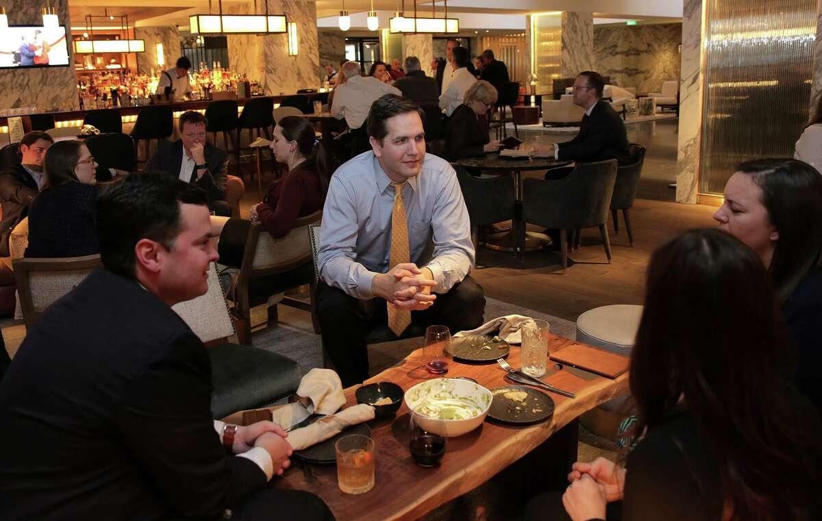 Co-workers Matthew Cavenaugh, from left, Richard Howell, Amanda Eichenbayum and Courtney Carlson Sigmund, enjoy happy hour at the Four Seasons bar downtown on Wednesday, Feb. 8, 2017, in Houston. ( Elizabeth Conley / Houston Chronicle )