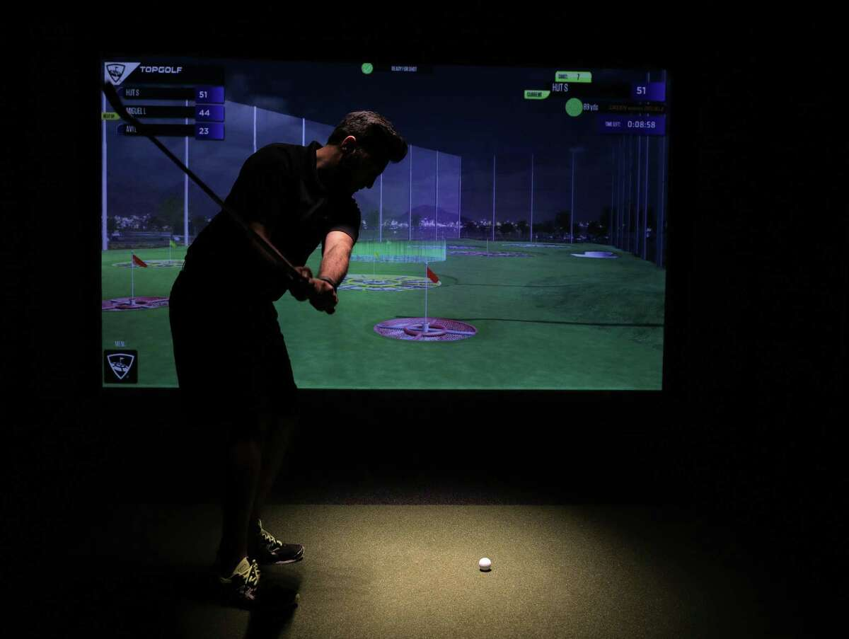 One of the offerings Four Seasons has for its guest is Top Golf game. ( Elizabeth Conley / Houston Chronicle )