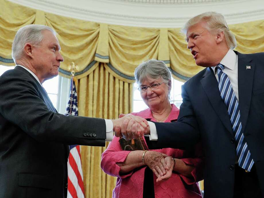 President Donald Trump shakes hands with Attorney General Jeff Sessions, accompanied by his wife Mary, after he was sworn-in by Vice President Mike Pence, Thursday, Feb. 9, 2017, in the Oval Office of the White House in Washington. Photo: Pablo Martinez Monsivais, AP / Copyright 2017 The Associated Press. All rights reserved.