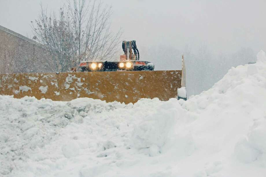 Snow gets piled up in the parking lot of Kohl's on Tunxis Hill Road Feb. 9. Photo: Genevieve Reilly / Hearst Connecticut Media / Fairfield Citizen