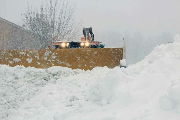 Snow gets piled up in the parking lot of Kohl's on Tunxis Hill Road Feb. 9.