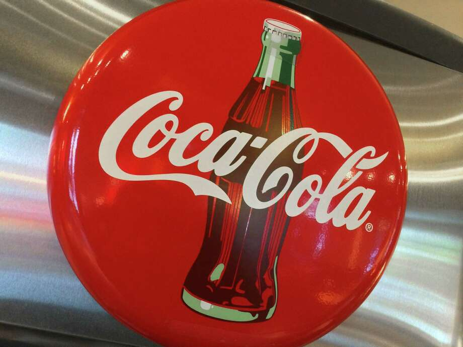 Coca-Cola Co.'s profit fell 55 percent to $550 million, or 13 cents per share, for the three months ending Dec. 31. Photo: AFP /Getty Images /File Photo / AFP or licensors