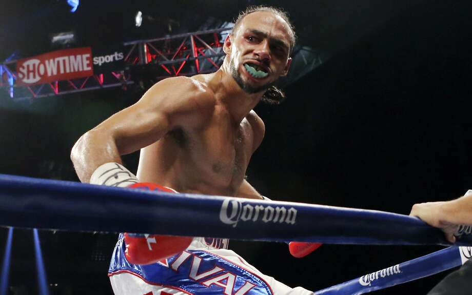 "Keith Thurman reacts after his WBA interim welterweight fight with Jesus Soto Karass — part of the ""Danger Zone"" boxing card — on Dec. 14, 2013 at the Alamodome. Photo: Edward A. Ornelas /San Antonio Express-News / © 2013 San Antonio Express-News"