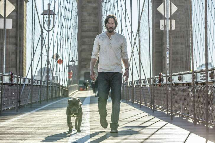 "Don't mess with John Wick or his new dog: Keanu Reeves in a scene from ""John Wick: Chapter 2."""