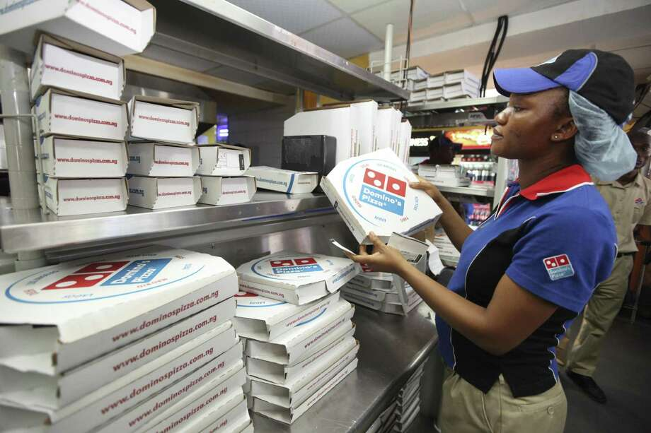 Domino's announced it launched a wedding registry site just in time for Valentine's Day. Photo: Associated Press /File Photo / A2013