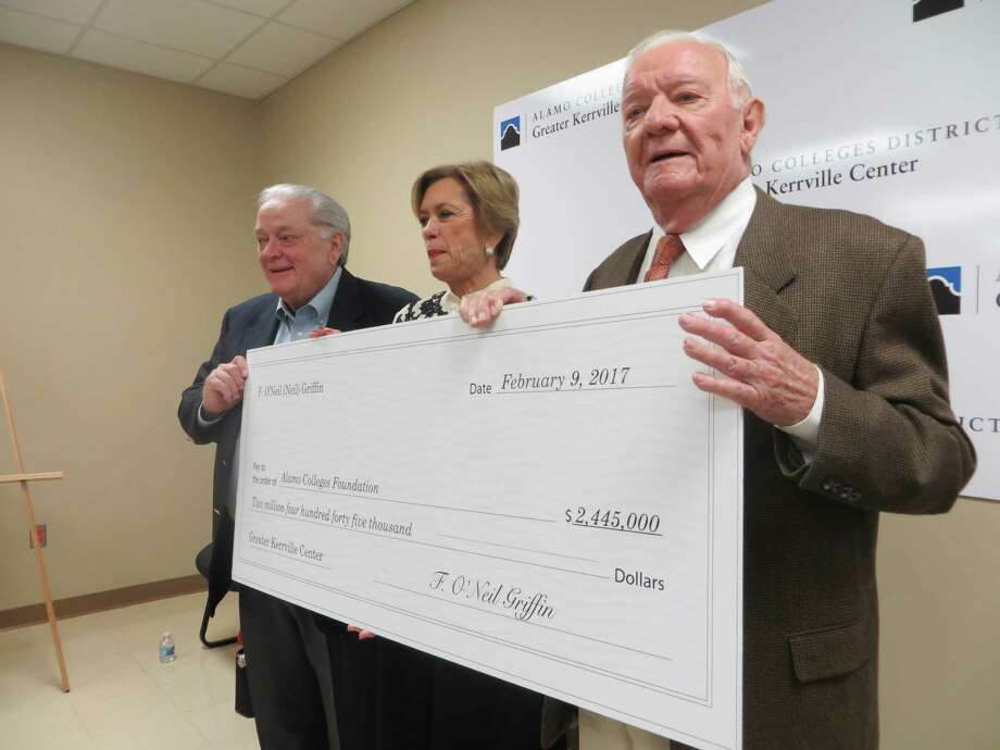Neil Griffin and his wife, Gena, presented a check for $2.445 million to the Alamo Colleges Foundation at a ceremony in Kerrville on Thursday, Feb. 9, 2017, to benefit the district's regional center in the Hill Country city. Shown left to right are Mike Giffin, Neil's youngest brother; Gena and Neil. Photo: Zeke MacCormack / San Antonio Express-News
