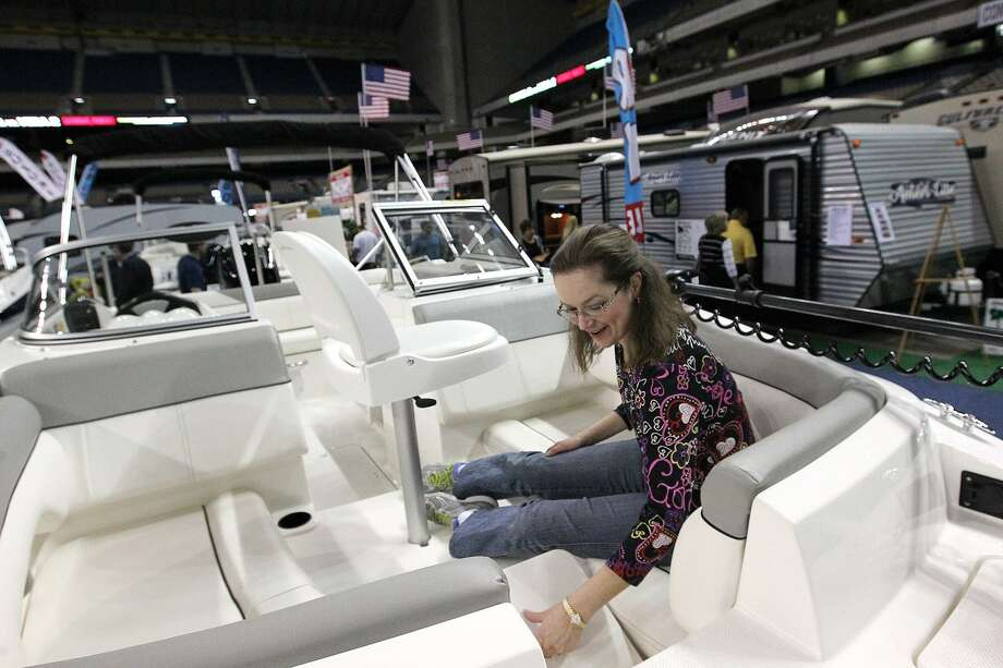 Amy McLin, of San Antonio, checks out the features of a boat during the San Antonio Boat and Travel Trailer Show at the Alamodome in 2014. Photo: Jerry Lara /San Antonio Express-News / © 2014 San Antonio Express-News
