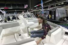 Amy McLin, of San Antonio, checks out the features of a boat during the San Antonio Boat and Travel Trailer Show at the Alamodome in 2014.