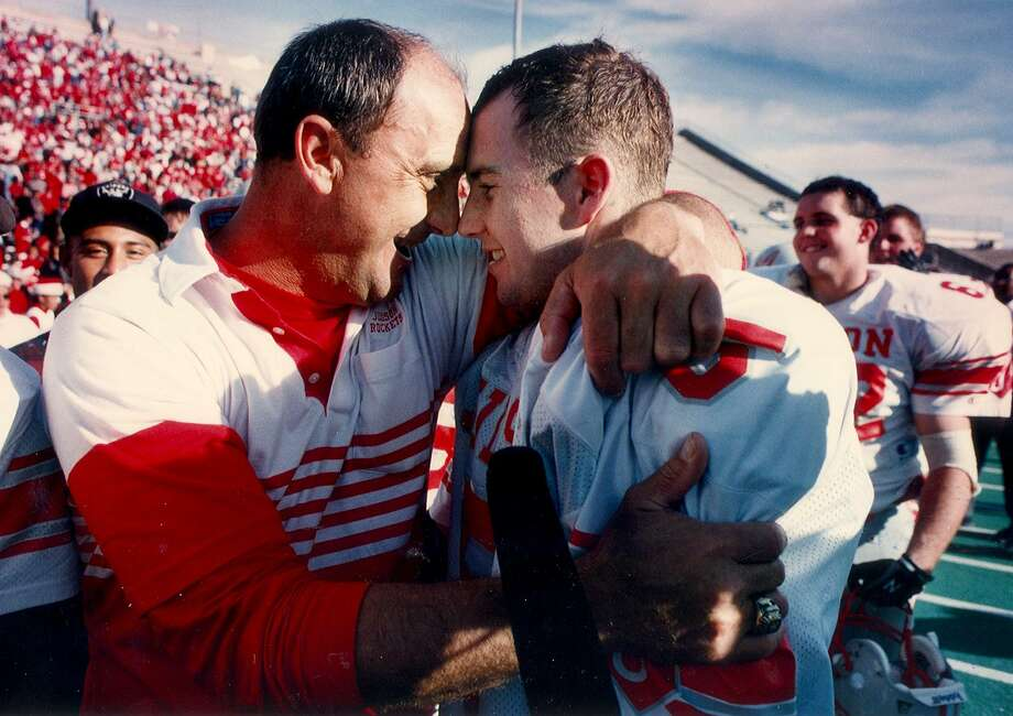 Judson coach D.W. Rutledge hugs his son Clint Rutledge, quarterback for the team, after the Rockets beat Plano Wildcats for a state title in Waco in 1993. Photo: Express-News File Photo