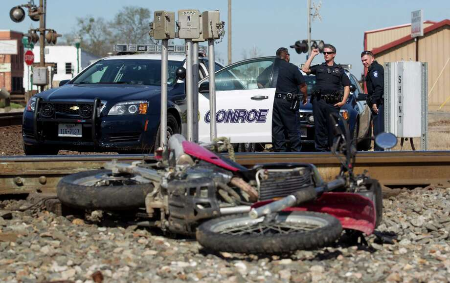 Officers with the Conroe Police Department work the scene of a high-speed chase on railroad tracks near near South Pacific Street and Avenue A Thursday, Feb. 9, 2017, in Conroe. Taylor Starks, 19, was arrested for felony evading with a motor vehicle after allegedly leading officers on a short chase through Conroe. Photo: Jason Fochtman, Staff Photographer / © 2017 Houston Chronicle