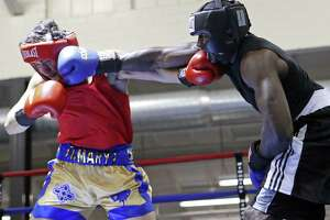 Luke Neftali Villafranca (left) and Terrence McKinney exchange punches during their light heavyweight championship bout in the semifinals of the 2016 San Antonio Regional Golden Gloves tournament on Feb. 26, 2016 at Woodlawn Gym.