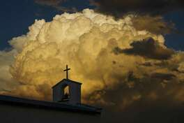 A thundercloud builds behind Mission Mary, a small adobe chapel established in 1902, Friday, Sept. 16, 2016 near Balmorhea. Houston-based Apache Corporation recently announced the discovery of an estimated 15 billion barrels of oil and gas in the area and plans to drill and use hydraulic fracturing on the 350,000 acres surrounding the town. A truck fire Thursday shut down a well site in Apache's Alpine High field .