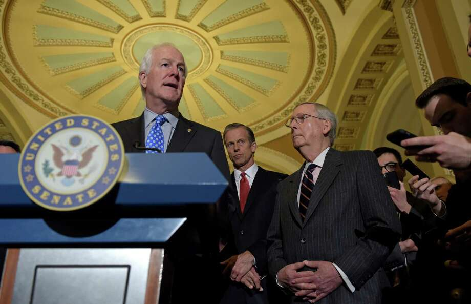 Senate Majority Whip John Cornyn of Texas, left, speaks to reporters during a news conference on Capitol Hill in Washington, Tuesday, Feb. 7, 2017. He is joined by Sen. John Thune, R-S.D., center, and Senate Majority Leader Mitch McConnell of Ky., right. (AP Photo/Susan Walsh) Photo: Susan Walsh, Associated Press / Copyright 2017 The Associated Press. All rights reserved.