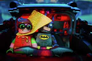 "This image released by Warner Bros. Pictures shows Robin, voiced by Michael Cera, left, and Batman, voiced by Will Arnett, in a scene from ""The LEGO Batman Movie."" (Warner Bros. Pictures via AP) ORG XMIT: NYET976"