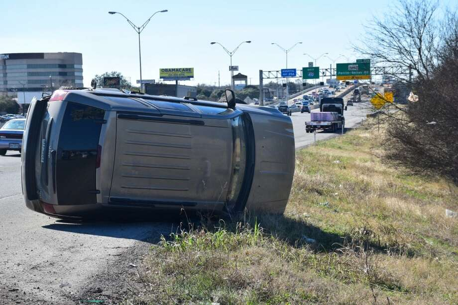 Police responded to the rollover involving a Jeep SUV and an 18-wheeler around 2:20 p.m. on Thursday, Feb. 9, 2017, in the 2900 block of Northeast Loop 410. Photo: Caleb Downs