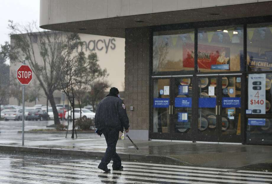 At Hilltop Mall in Richmond, the Sears Automotive Center operates near a Macy's store. Photo: Leah Millis, The Chronicle