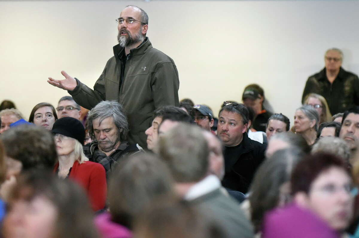 Tony Malikowski, Hoosick Falls High science and technology teacher, left, speaks during a community meeting addressing the PFOA groundwater contamination in the village and wells in the Town of Hoosick on Saturday, Jan. 30, 2016, at Bennington College in Bennington, Vt. Environmental activist Erin Brockovich and the Weitz & Luxenberg law firm led the meeting. (Cindy Schultz / Times Union)