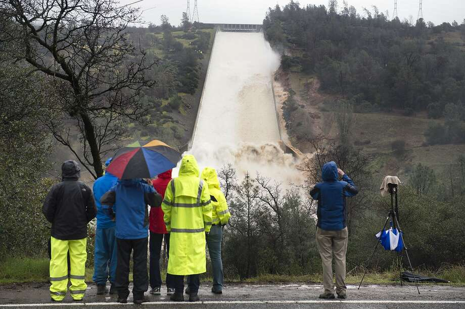 A huge hole has opened in the Oroville Dam spillway, but officials say the dam is in good condition. Photo: Randy Pench, Associated Press