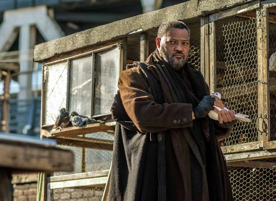 "This image released by Lionsgate shows Laurence Fishburne in a scene from, ""John Wick: Chapter 2."" (Niko Tavernise/Lionsgate via AP) ORG XMIT: NYET967 Photo: Niko Tavernise / Lionsgate"