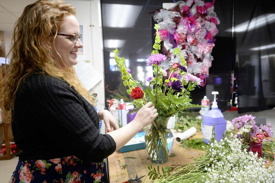 Jenny Cudd, owner of Becky's Flowers, prepares an arrangement on Tuesday, Feb. 7, 2017, at Becky's Flowers. James Durbin/Reporter-Telegram Photo: James Durbin