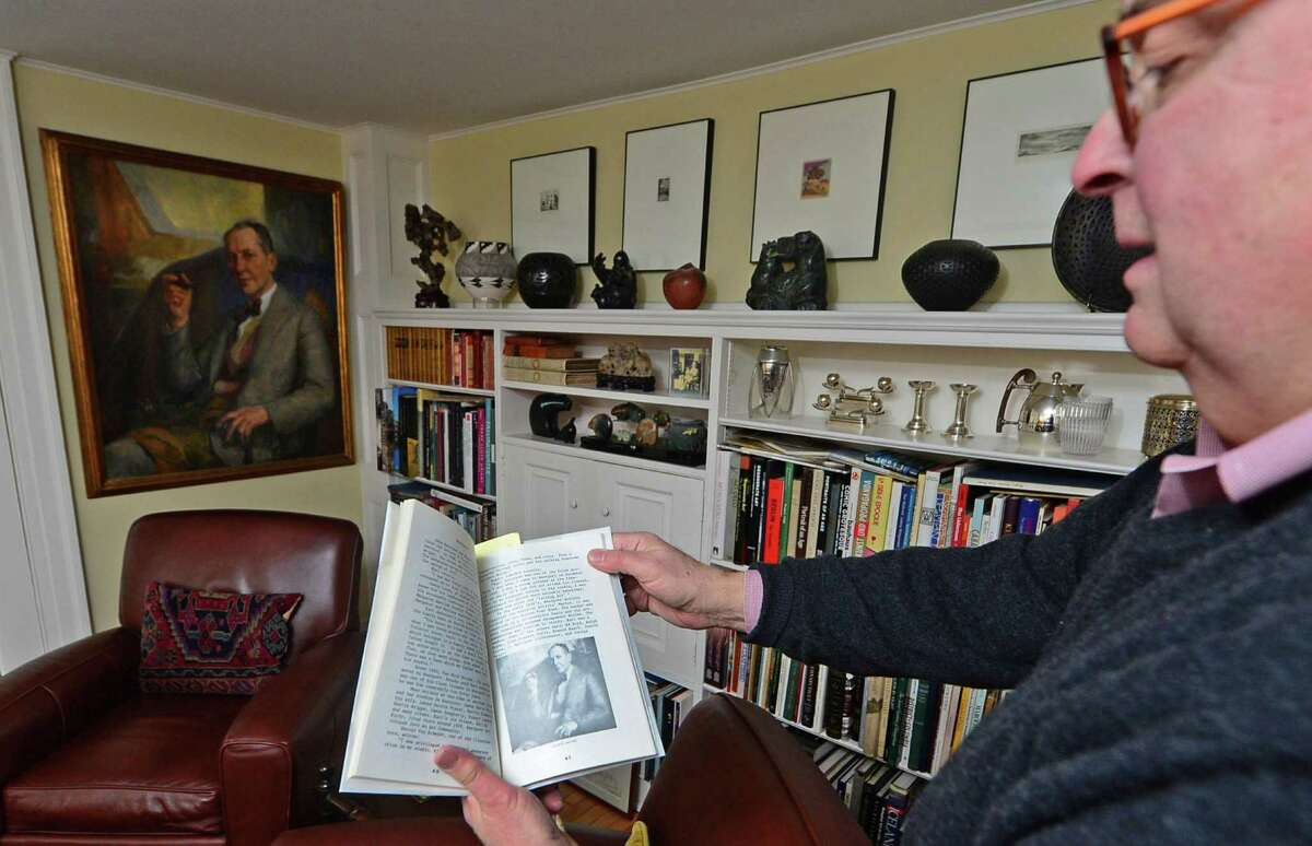 Ed Gerber indicates that a portrait of George Hand Wright that he owns appeared in a book on The Westport Artist Colony at his home at 93 Cross Highway Tuesday, January 31, 2017, in Westport, Conn. The historic property was once home to George Hand Wright, who was considered by many to be the founder of the Westport Artists Colony. The home also appears on the National Register of Historic places.