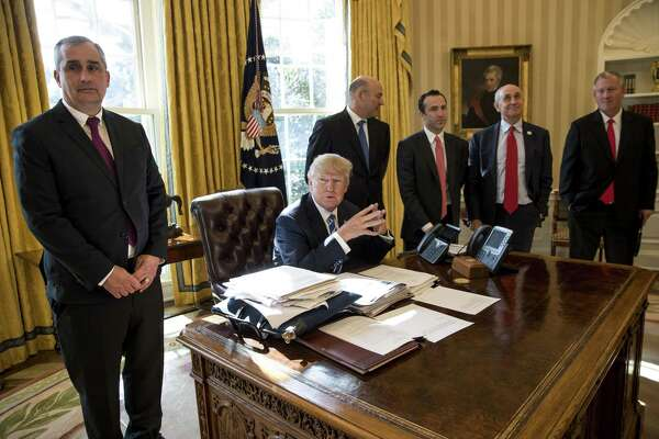 President Donald Trump meets with Brian Krzanich, left, the chief executive of Intel, at the White House in Washington, Feb. 8, 2017. Tech companies — including Facebook Inc. and Amazon.com Inc. — that were previously lauded as innovators are facing increased scrutiny over their size, their hiring practices and whether online news feeds skew liberal.