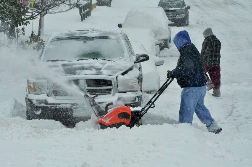 Larry Somma uses a snowthrower to help a neighbor get his car out of the snow during a snowstorm on Thursday February 9, 2017 in Norwalk Conn