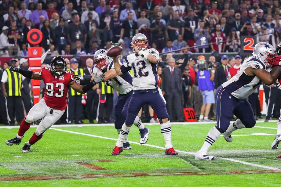 New England quarterback Tom Brady throws a pass on the game-winning drive during overtime of Super Bowl LI against the Atlanta Falcons. A reader claims the Patriots won because of bad calls by the refs. Photo: Anthony Behar /TNS / Sipa USA