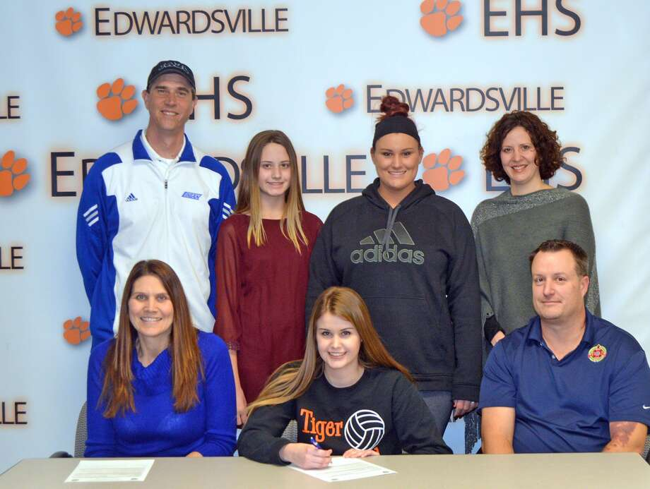 Edwardsville senior Shelbey Saye will play volleyball at John A. Logan College. In the front row, from left to right, are mother Brenda Saye, Shelbey Saye and father Doug Saye. In the back row, left to right, are John A. Logan coach Bill Burnside, sisters Gabby Saye and Camrey Saye and EHS coach Jami Parker.