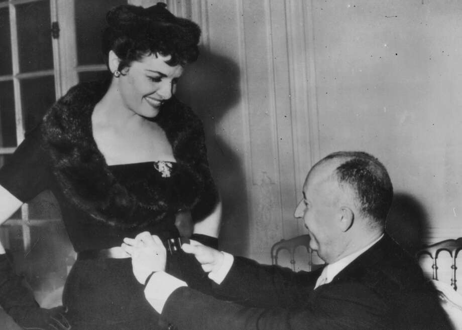 Screen star Jane Russell meets French fashion designer Christian Dior (1905 - 1957) in Paris for a fitting of one of Dior's much vaunted 'H' line creations.   (Photo by Keystone/Getty Images) Photo: Keystone/Getty Images